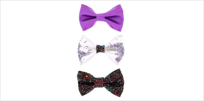 Go to Product: Holographic Glitter Bow Hair Clips - Purple, 3 Pack from Claires