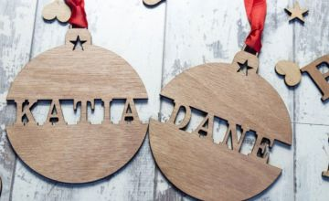 £1.99 instead of £11.99 (from Personalised Gifts Market) for two personalised wooden Christmas tree decorations, £2.99 for four, or £3.99 for six - save up to 83%