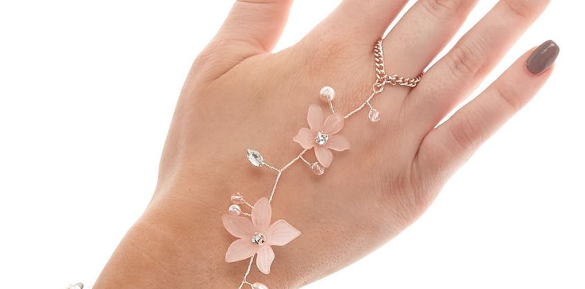 Go to Product: Rose Gold Frosted Flower Hand Chain - Pink from Claires