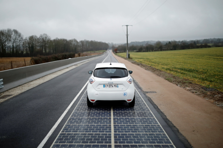 Concrete/asphalt surfaces which use heated photovoltaic panels to automatically re-fuel electic cars as they drive.