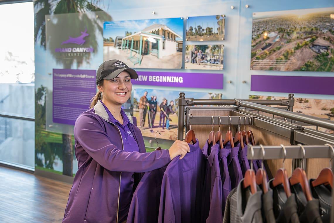 Woman stocking GCU Golf Course Apparel