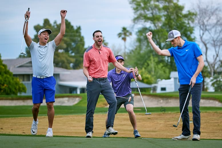 four golfers celebrating