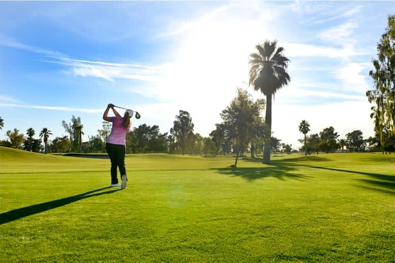 Woman golfer swinging the club