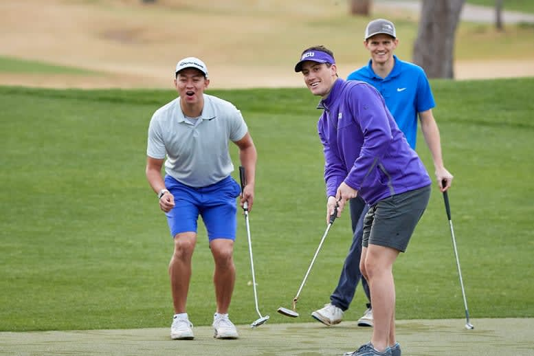 three men putting
