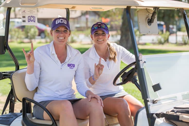 two GCU golfers on a golf course