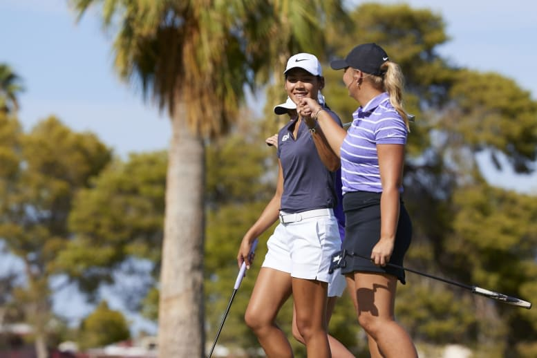 two GCU women golfers pumping fist