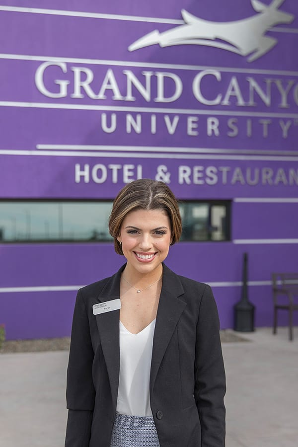 GCU Hotel employee in front of Hotel