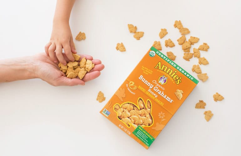 handful of bunny grahams served to a child
