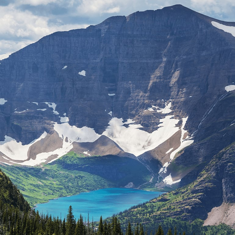 Pristine thick forests, colorful alpine meadows, rugged glacial mountains, and cold lakes and streams