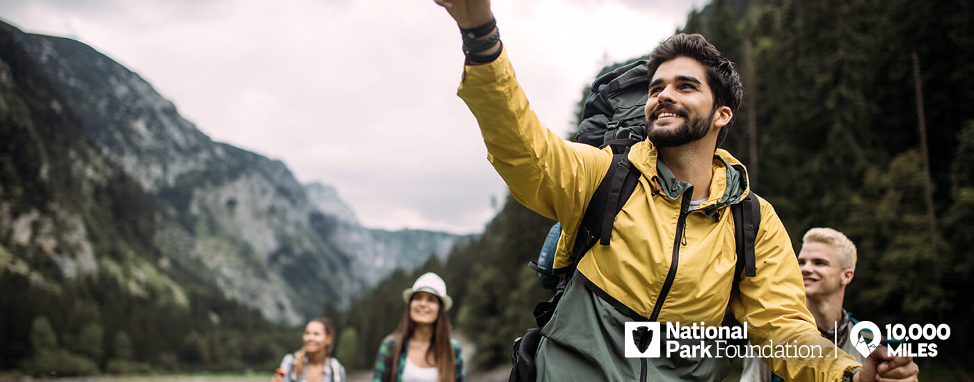 10000 Miles, A man with a beard leads a group of people on a hike
