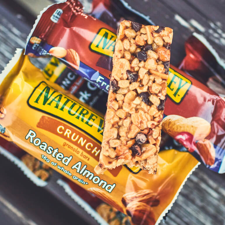 Oats and Dark Chocolate Bar placed over nature valley roasted almond and fruit nut bar