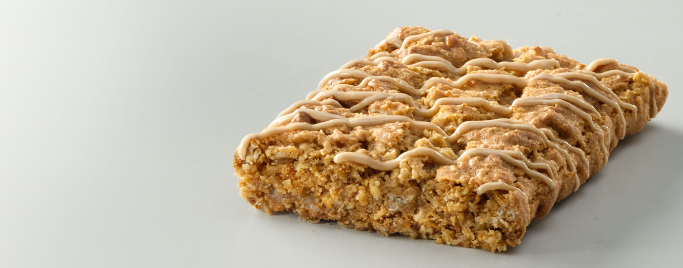 Soft baked oat meal square drizzled with Peanut Butter