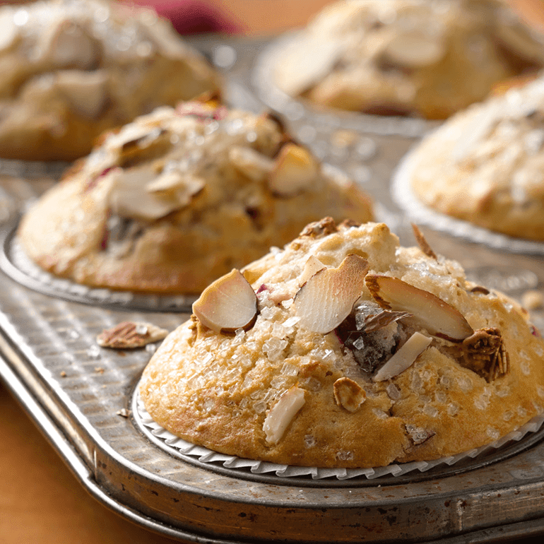 lovely cranberry muffins topped with almond slices