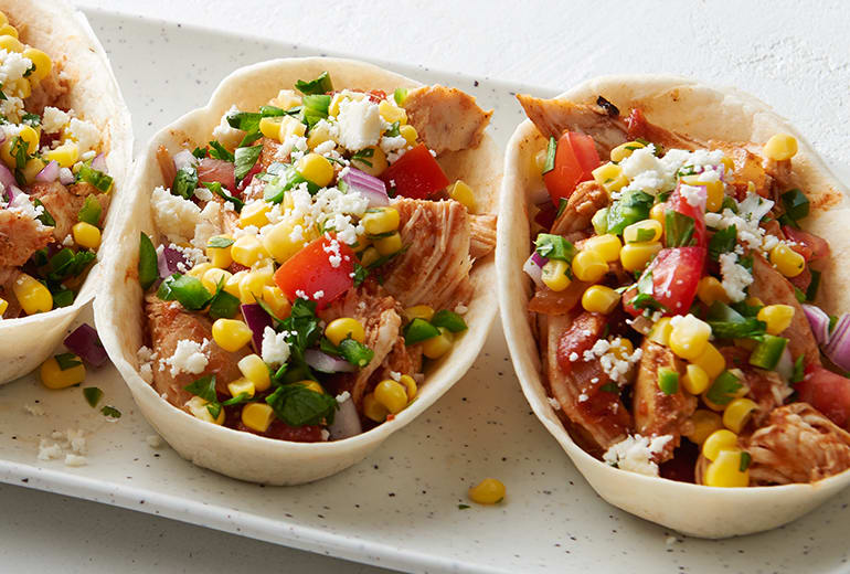 close up of 3 Slow-Cooker Chipotle Chicken Taco Bowls with Corn-Jalapeño Salsa