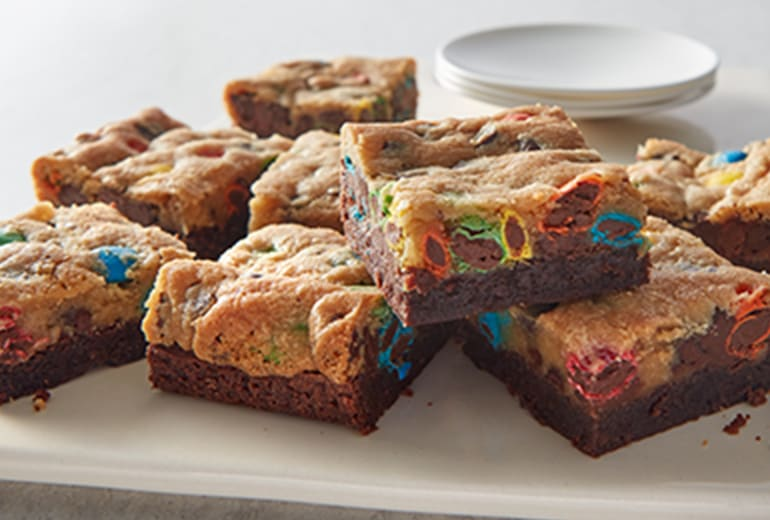 brookie bars piled high on a serving tray