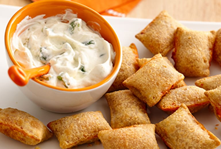 Jalapeño popper dip surrounded by pizza rolls