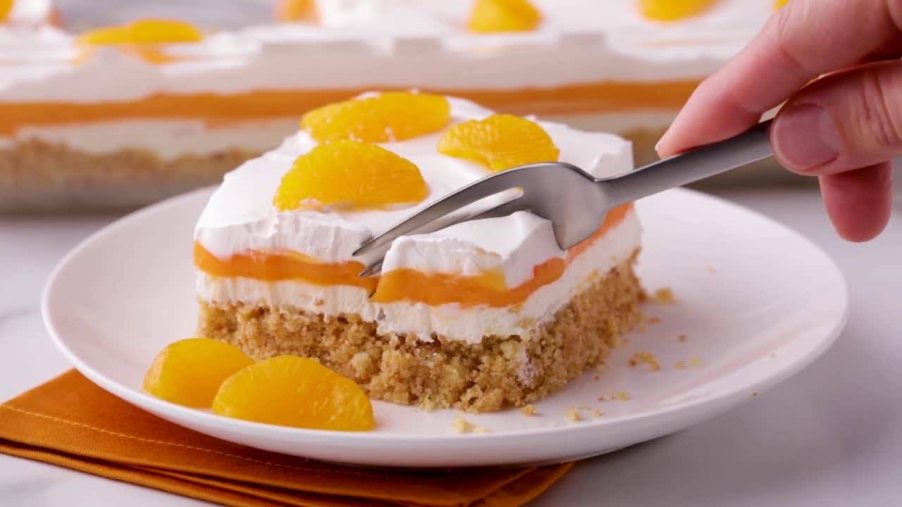 Video thumbnail image. Orange Creamsicle Lush | Betty Crocker Recipe
