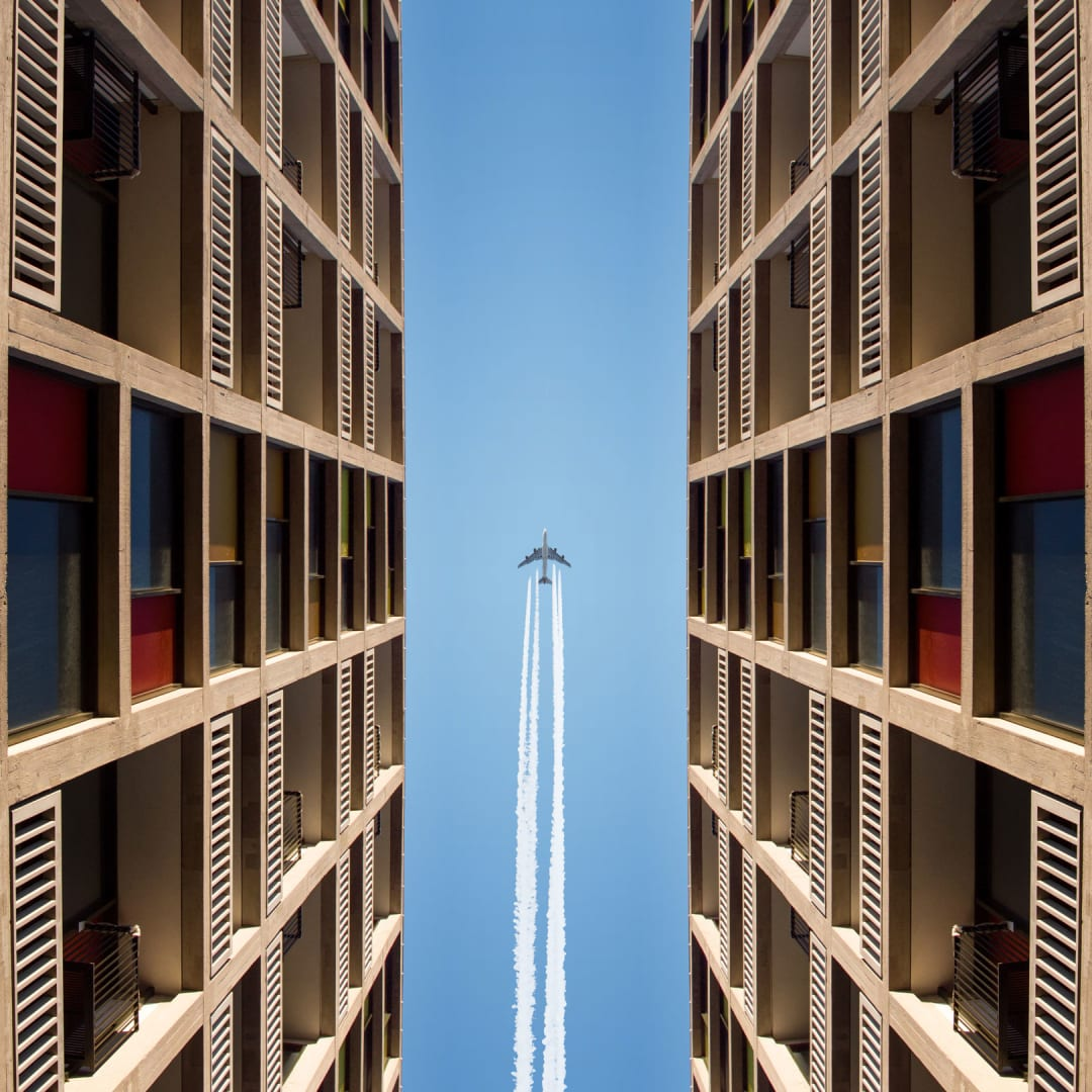An aeroplane flying above Park Hill flats in Sheffield