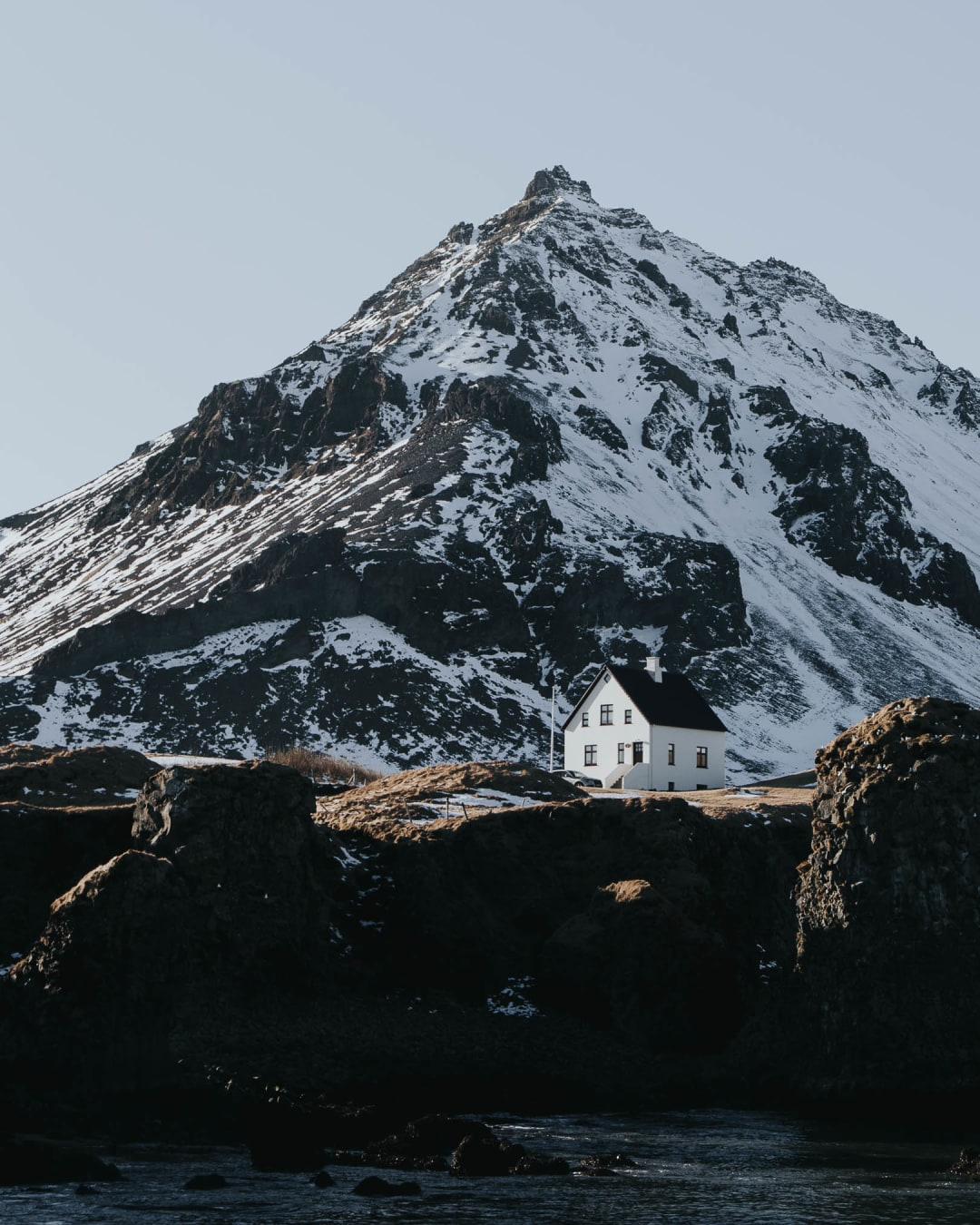minimal house in the snowy mountains landscape photography of Iceland