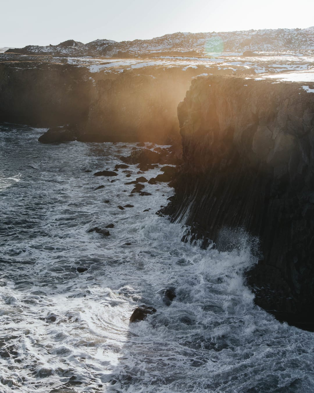 sea waves crashing onto the cliffs landscape photography of Iceland