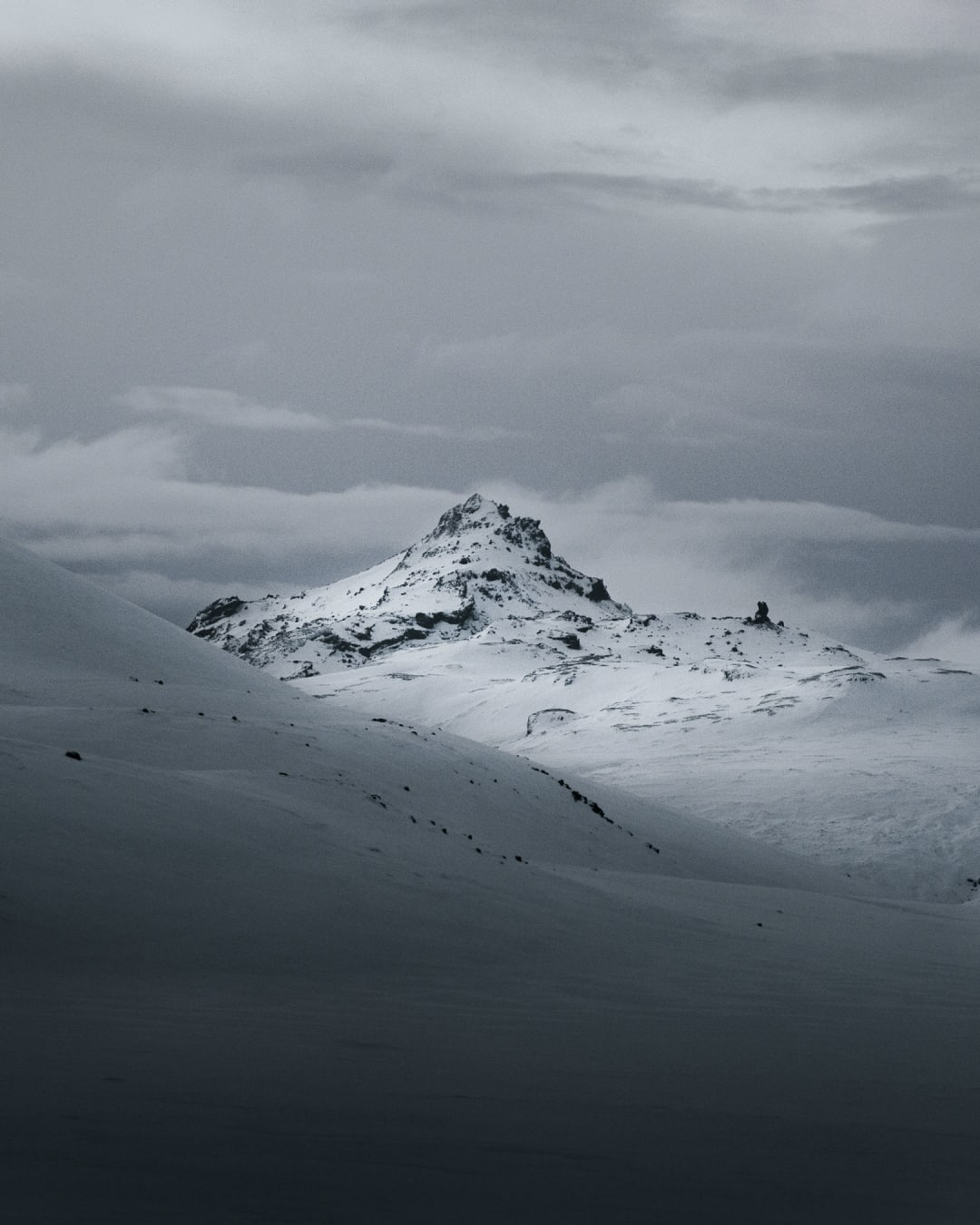 a stark and minimal snowy mountain scene landscape photography of Iceland