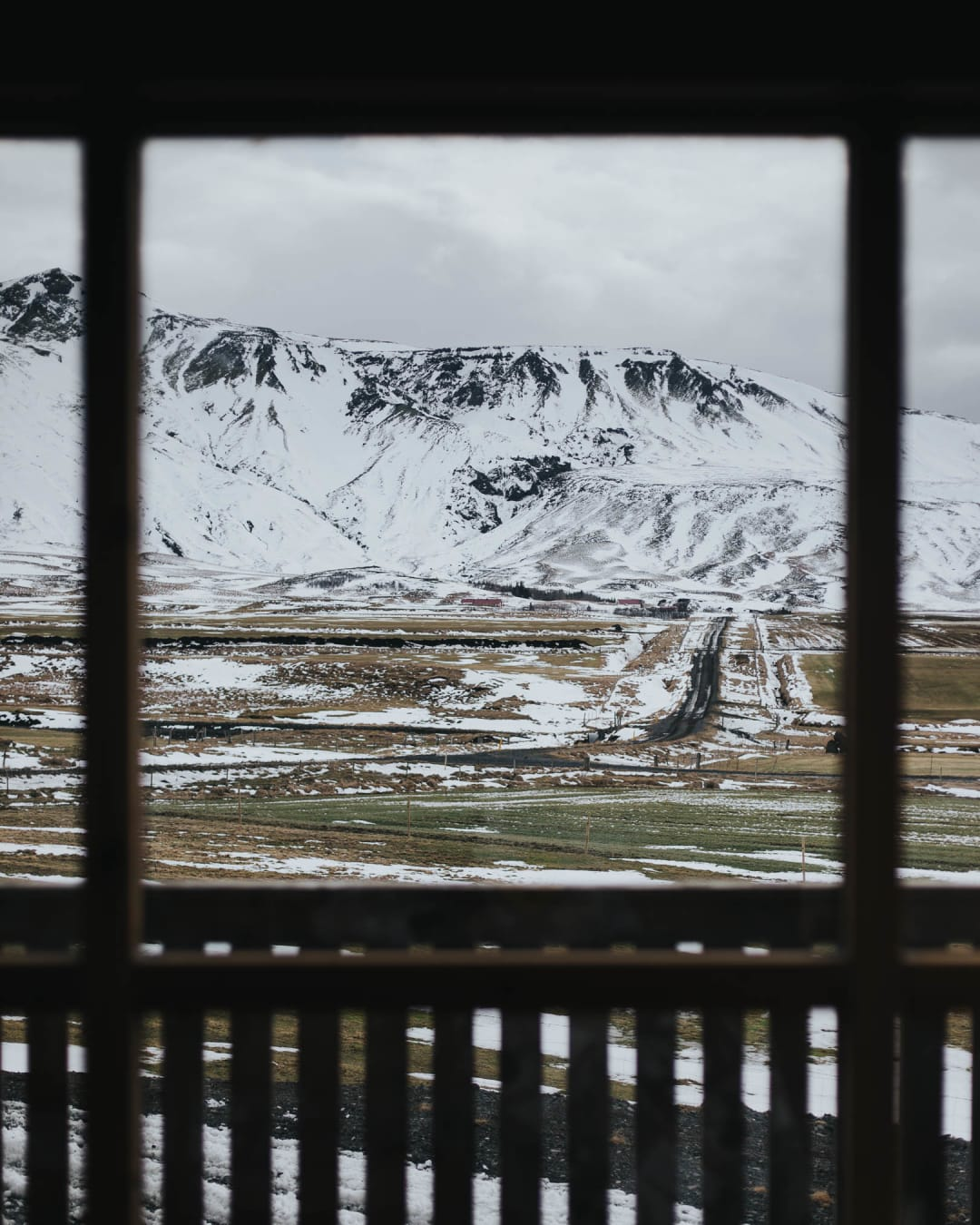 snow landscape viewed from within a cabin landscape photography of Iceland