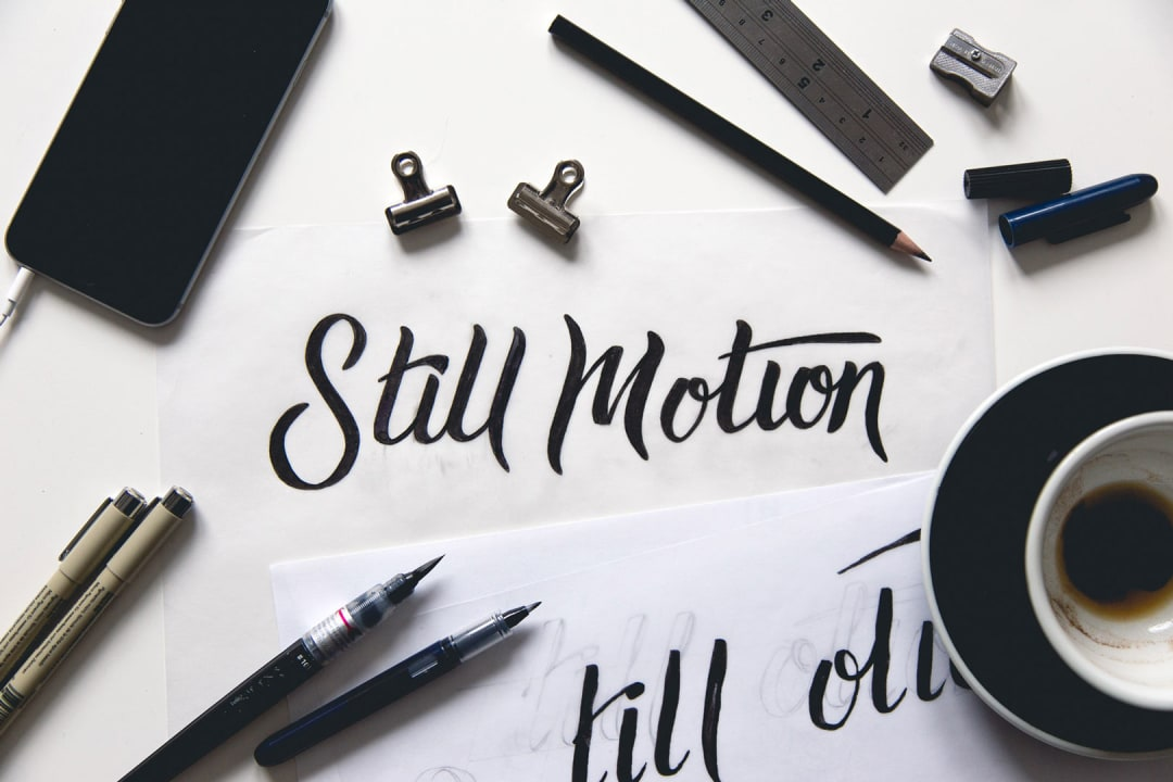In Still Motion Photography hand lettering process photo