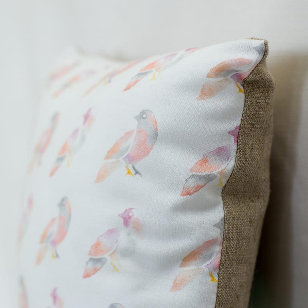 Made By Maria bird logo on cushion
