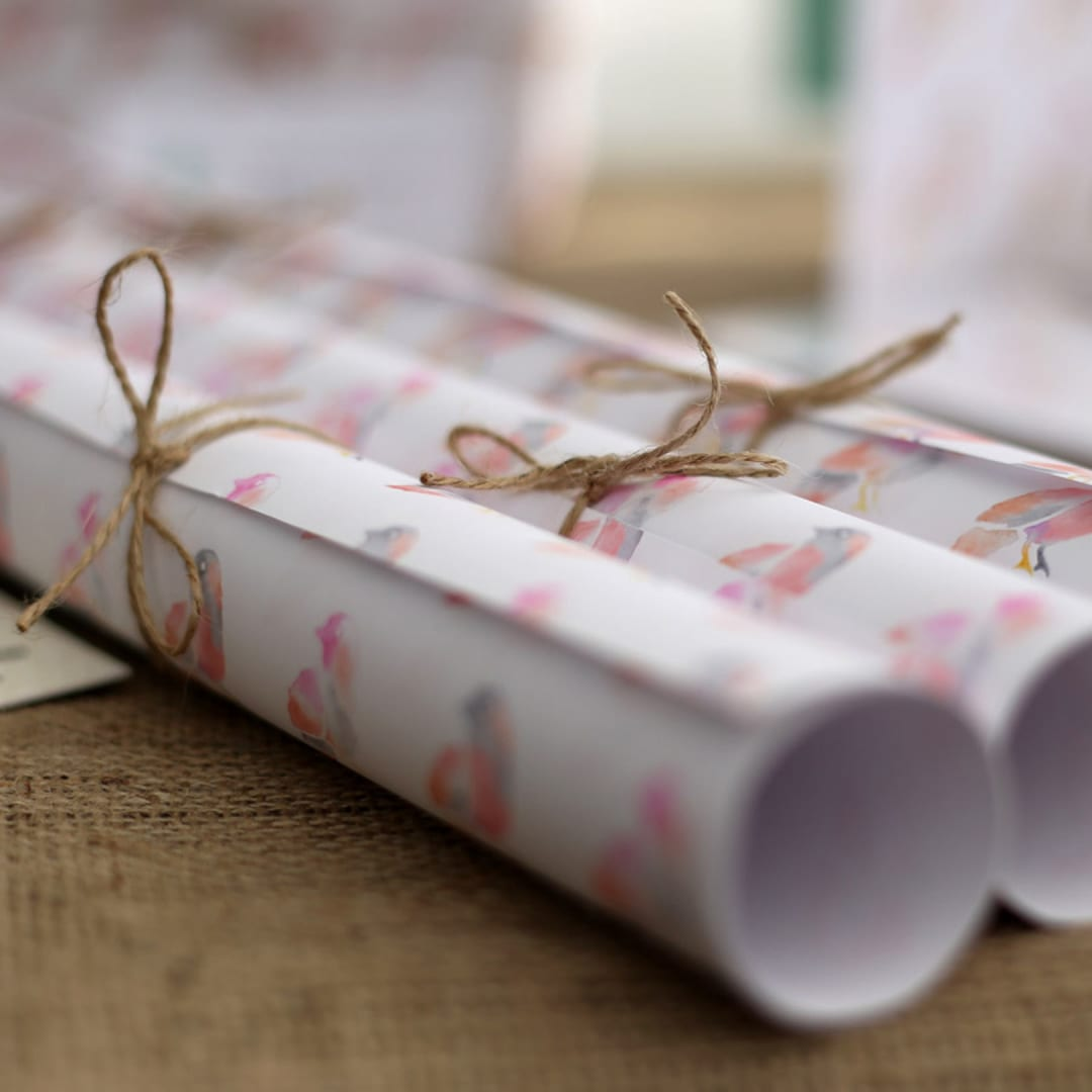 Made By Maria bird logo on wrapping paper