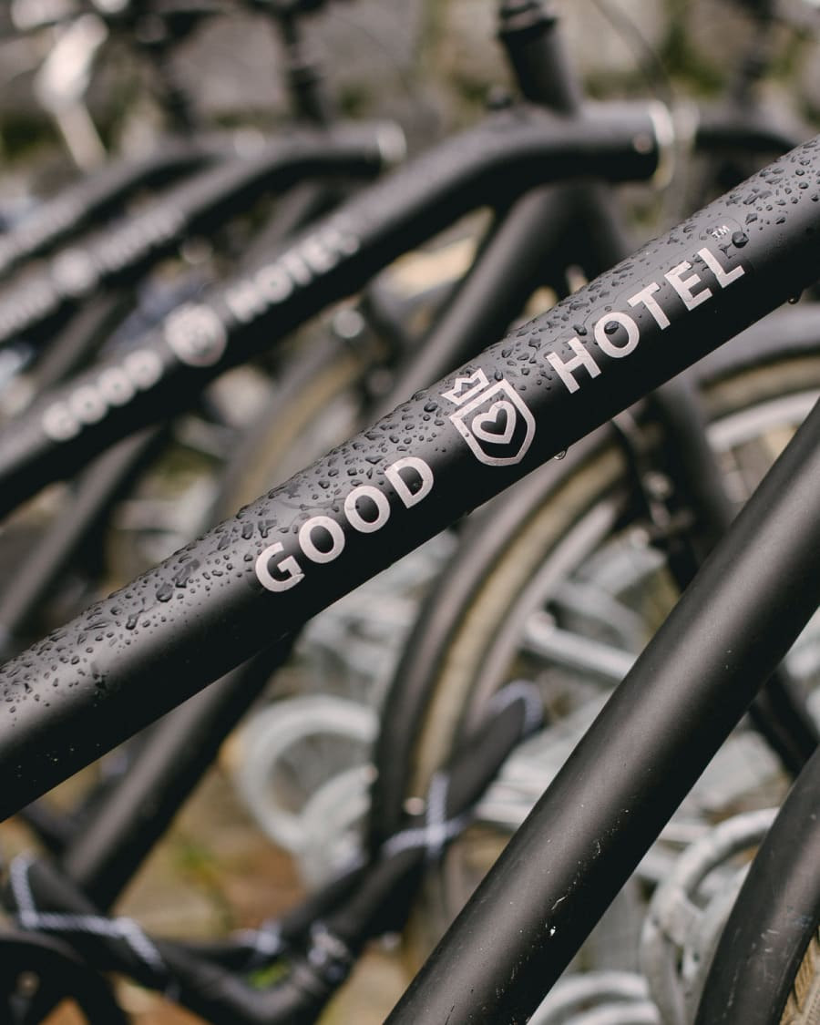 A rack of black bikes from Good Hotel in Amsterdam