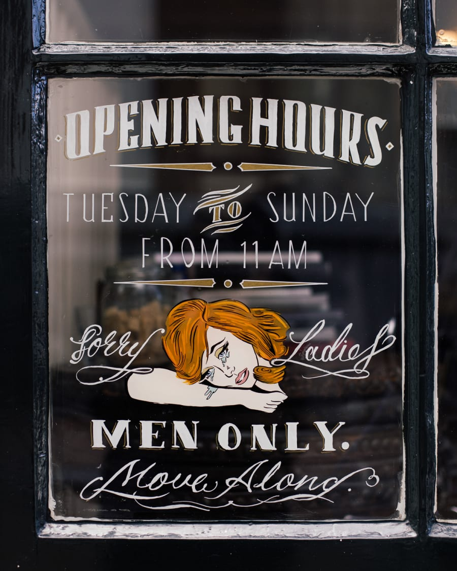 Men only sign design on a barber shop window in Amsterdam