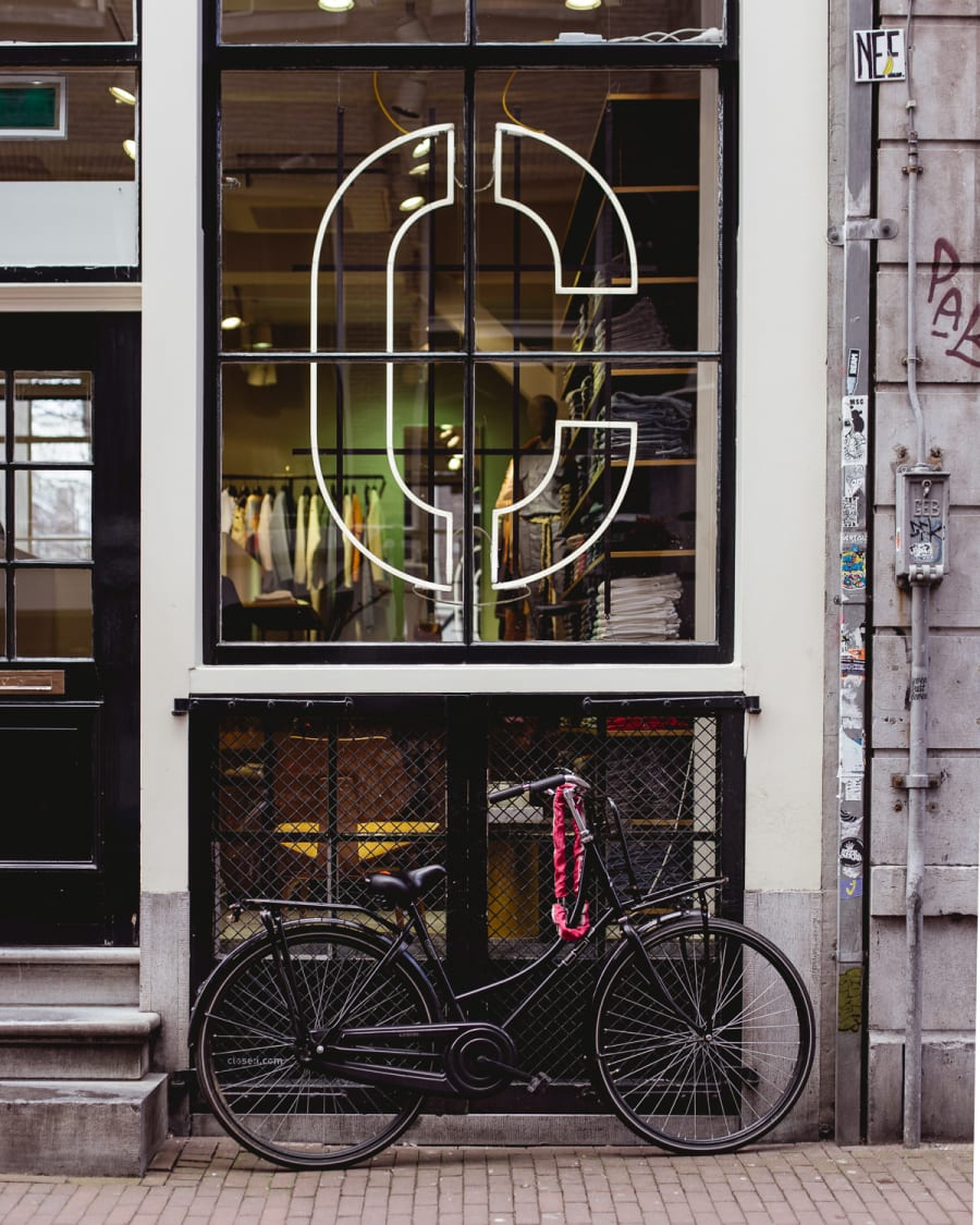 Bicycle outside of a shop on a street in Amsterdam