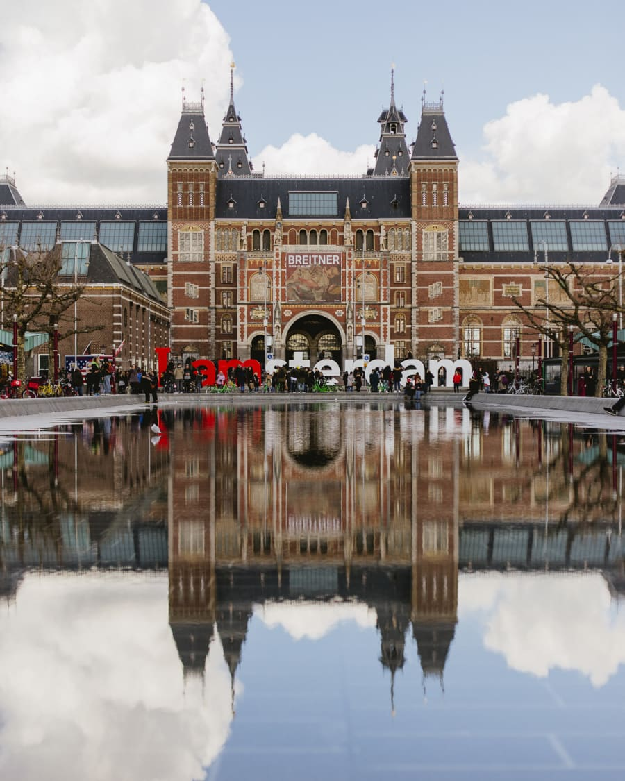 Reflection in the water of the I Amsterdam sign in front of the Rijksmuseum