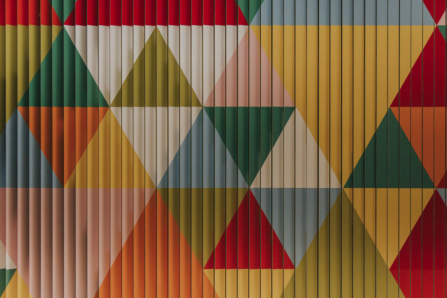 colourful shapes revealed by the sliding display inside the Design Museum