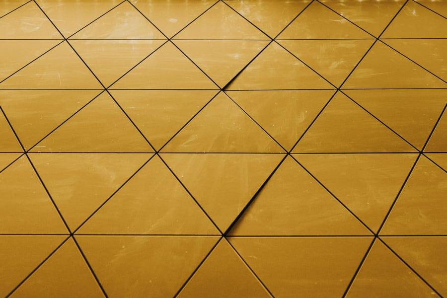 shiny triangular yellow tiled wall