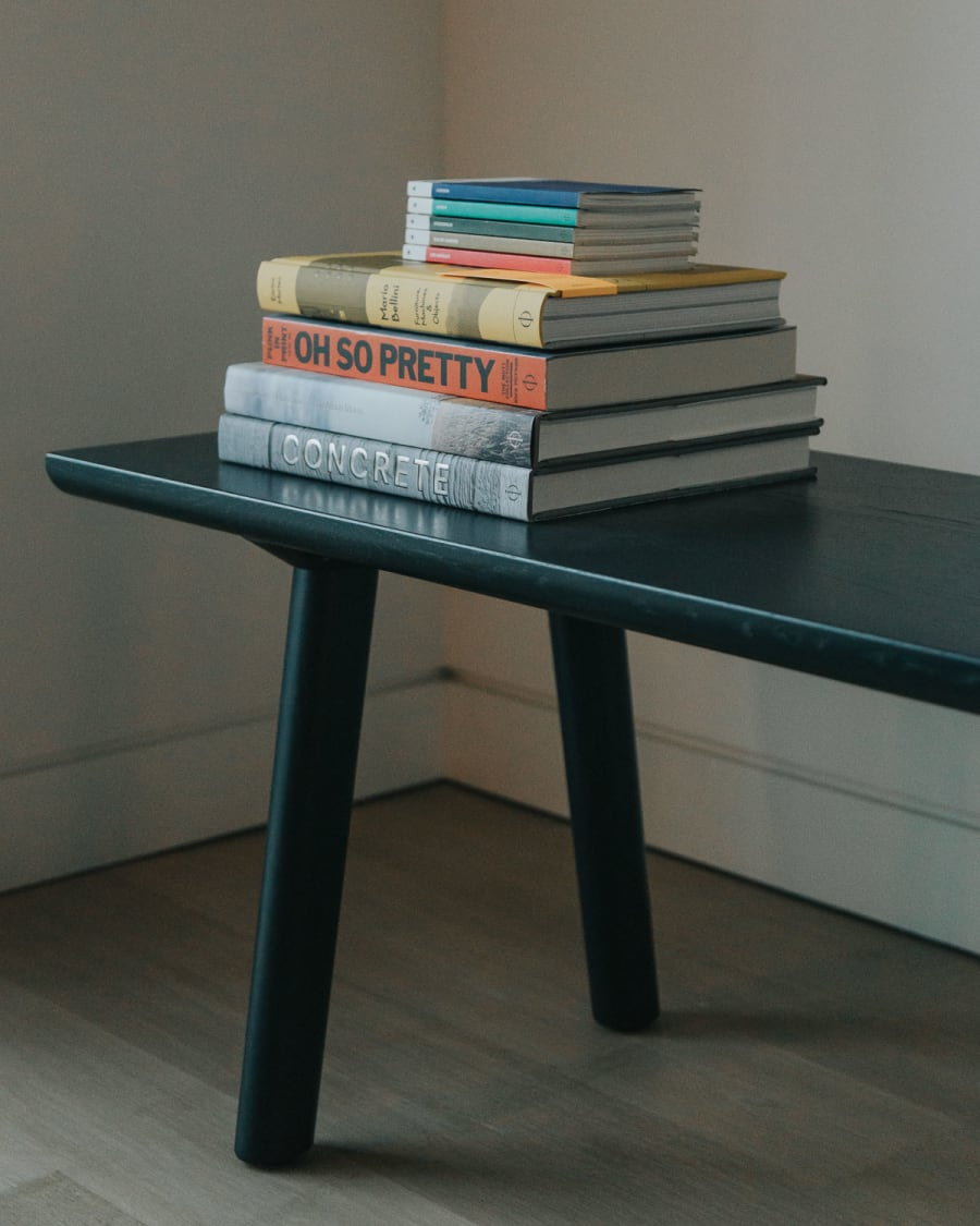 a pile of books on a stool