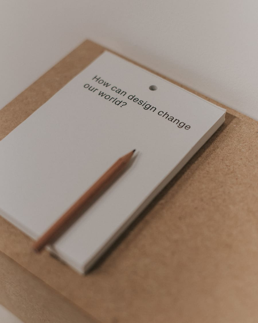 how can design change our world? pencil and note pad
