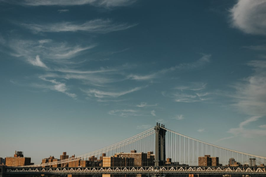 Manhattan bridge from the side with a clear blue sky above
