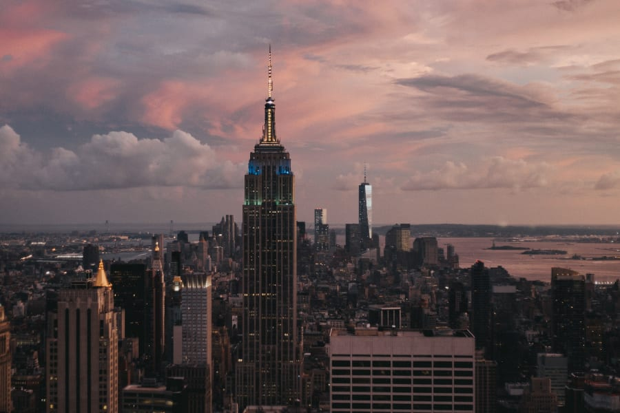 A red sky at dusk overlooking Manhattan including the Empire State building and One World Trade Center. Photo taken from Top Of The Rock