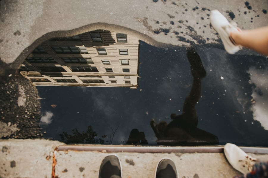 Reflection of a building in a puddle