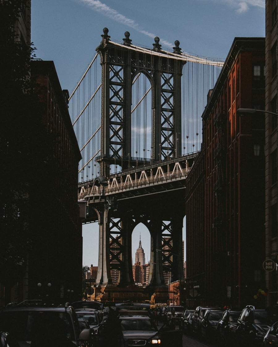 A view of the Empire State building framed by the arch of Manhattan Bridge taken from Washington Street in Dumbo, Brooklyn