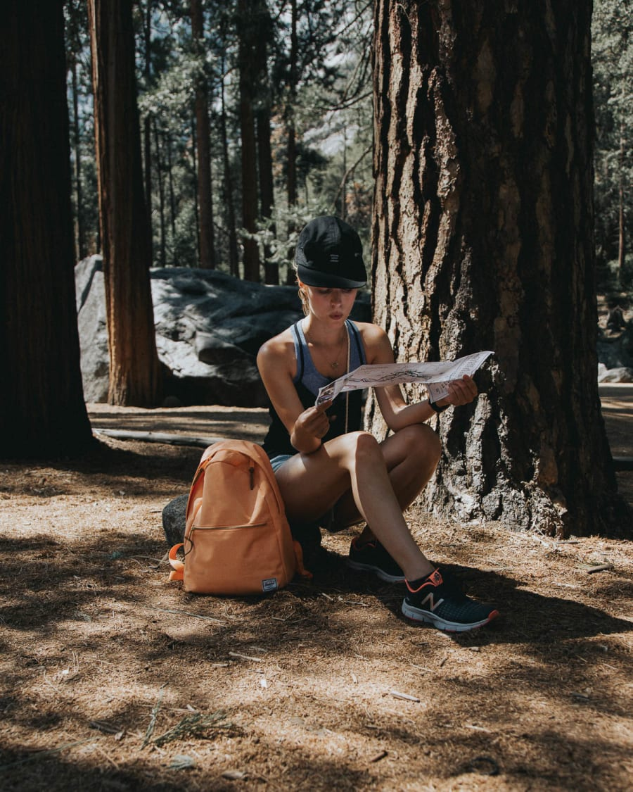 Girl checking the map in Yosemite valley
