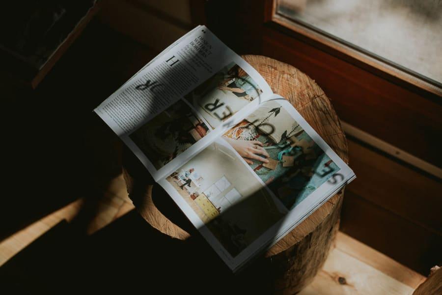 Sunlight hitting an open magazine through a shop window in Portland, Oregon.