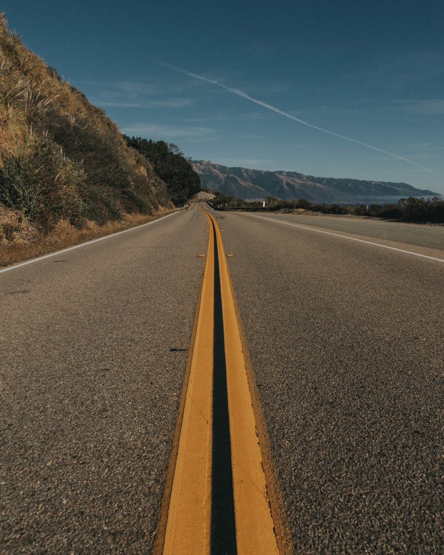 A photograph looking down the road of route one in California
