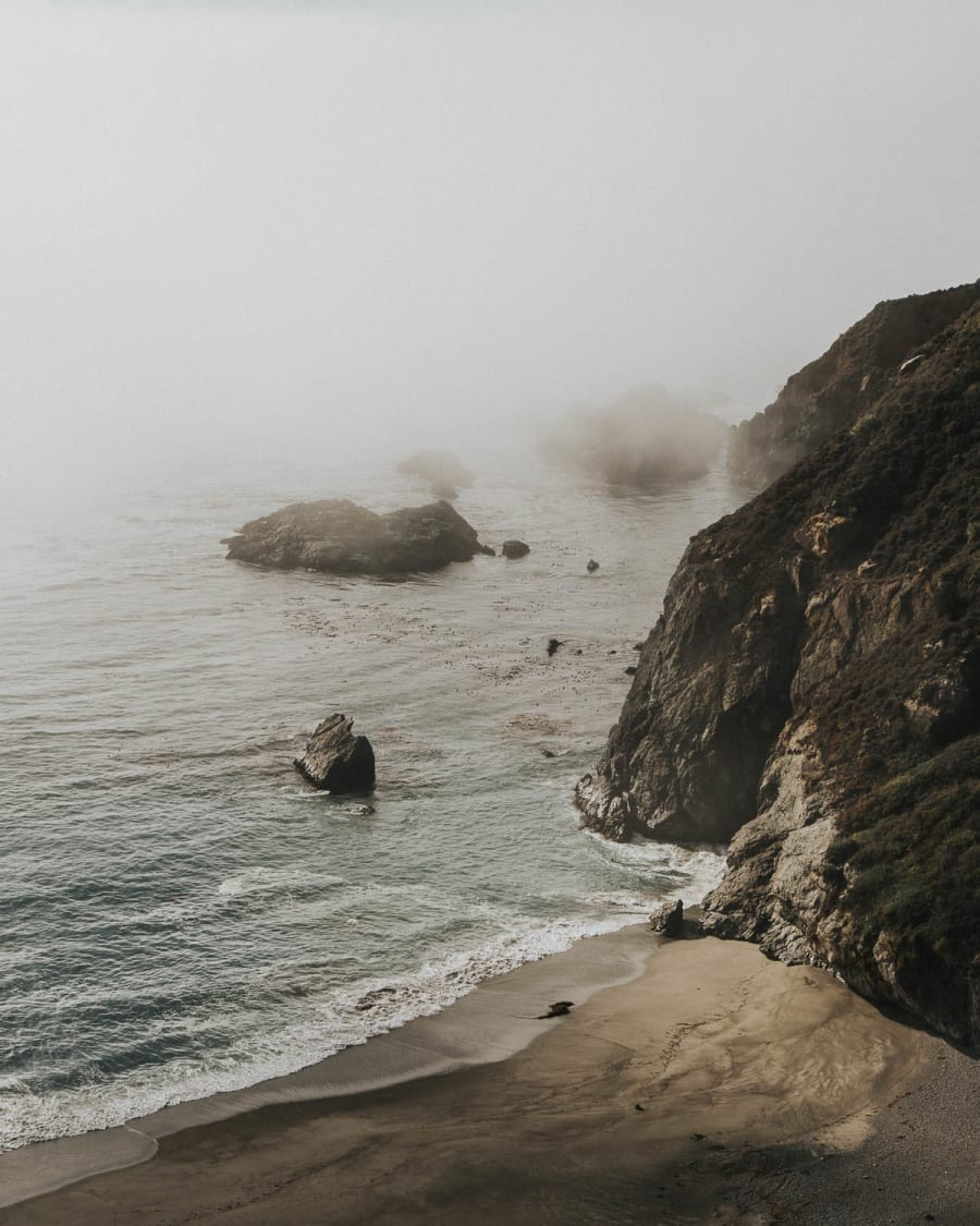 A misty beach, hills, and sea scene along California's Cabrillo Highway