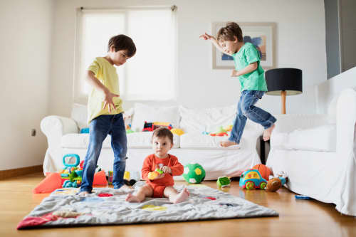 Children having play time in living room
