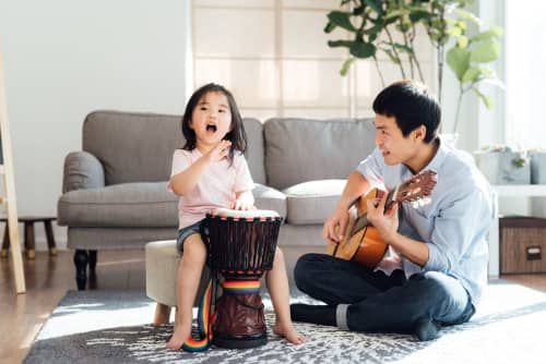 father and daughter playing instruments