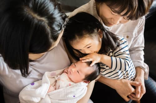 Three Generation Asian Family With A Newborn Baby