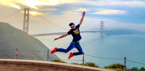 jumping in front of the Golden Gate bridge