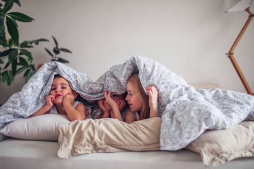 kids playing under covers